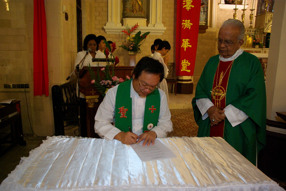 Fr Liew signing