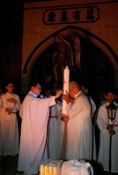2 priests and candle
