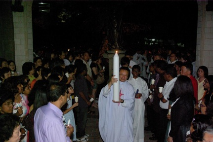 Fr Liew and Easter candle