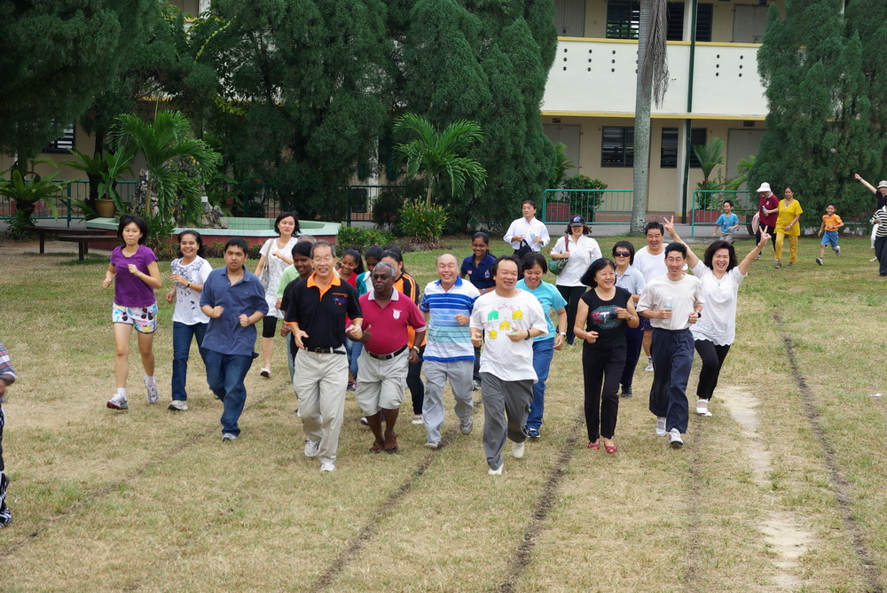 Fr Liew leads SMC parishioners in jogging