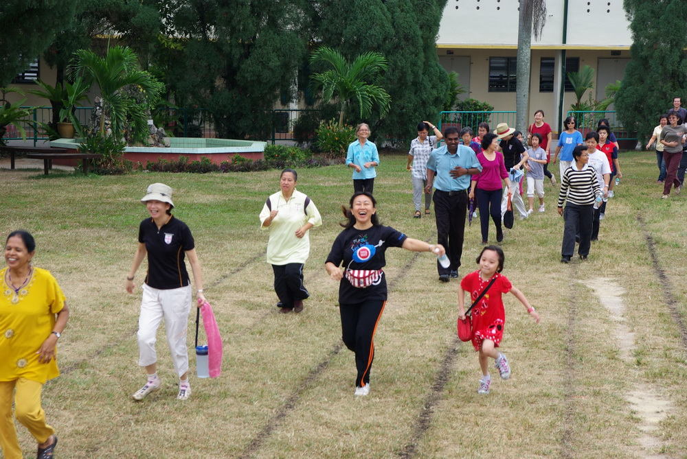 Participants jogging round field before events