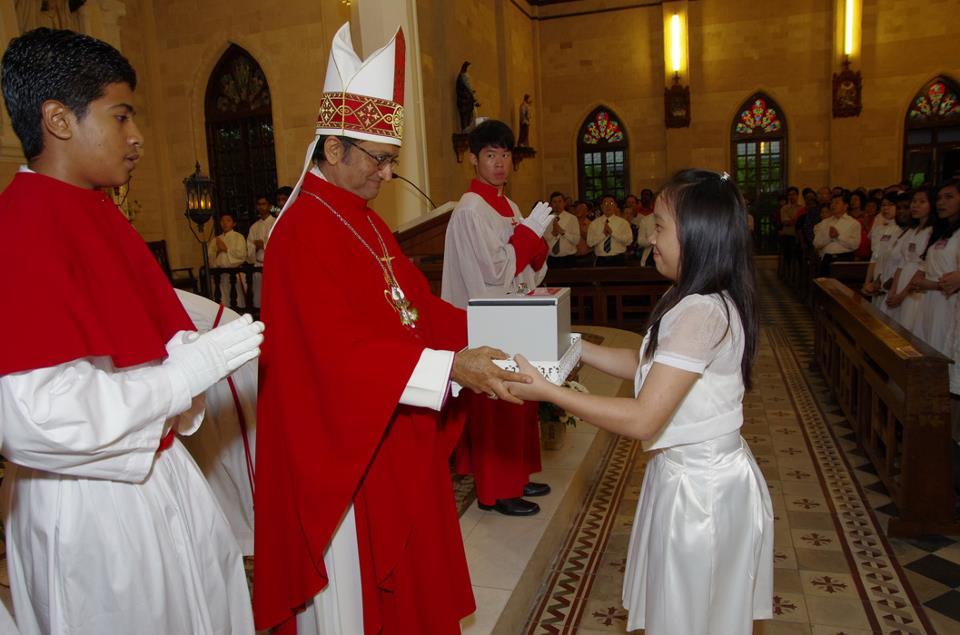 Bishop receiving collection from Confirmands serving as Wardens