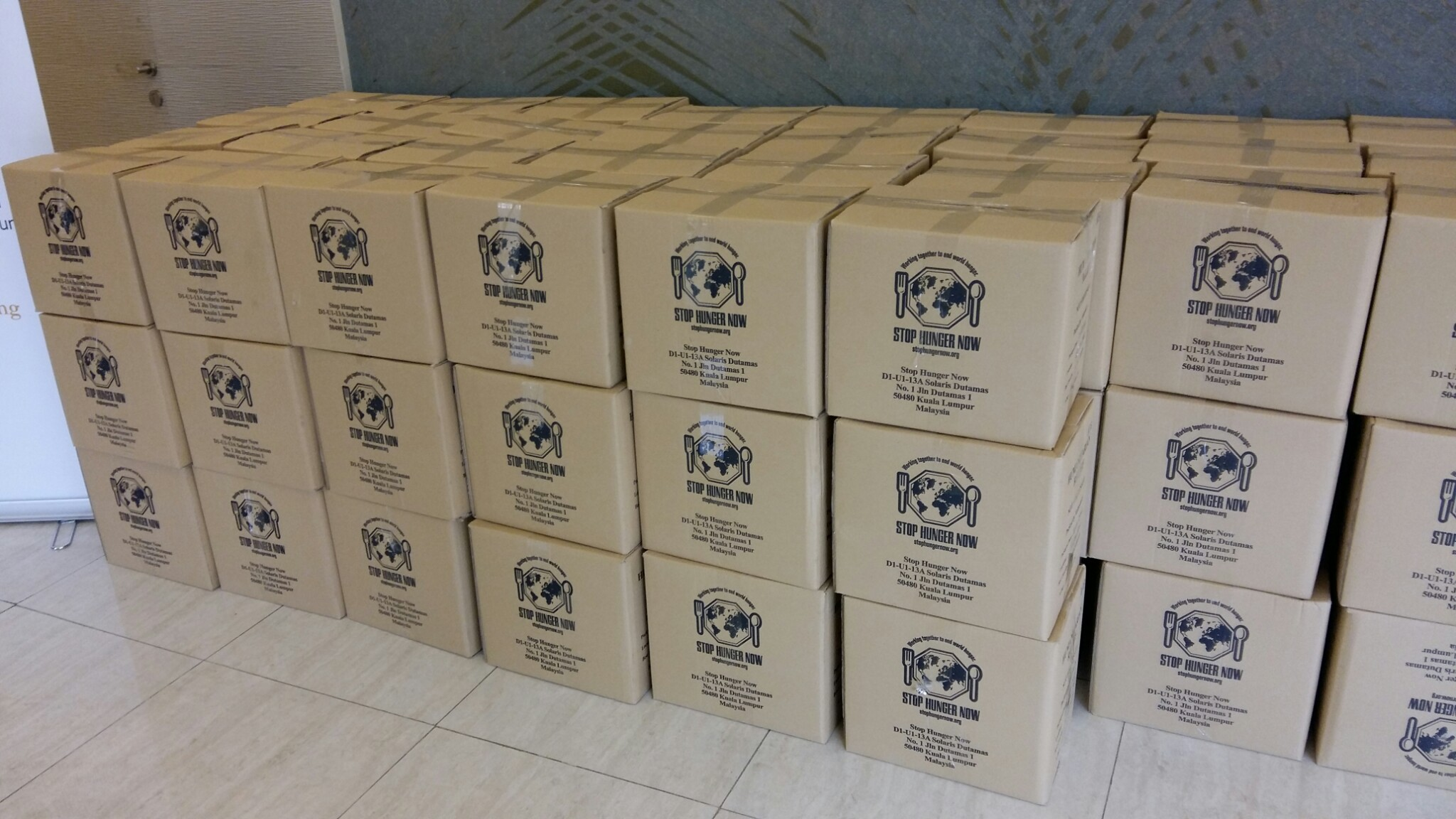 Stop Hunger Now fortified rice packs in boxes