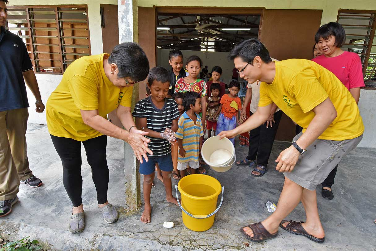 Teaching children to wash hands at Kg Sinju