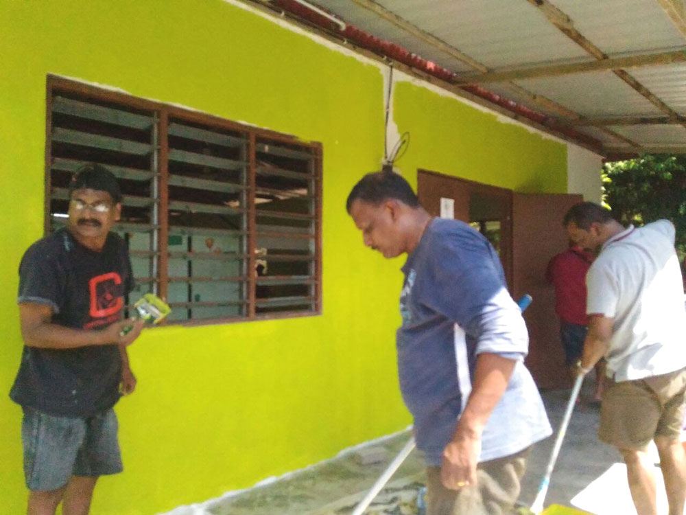 SSVP members painting exterior of chapel cum learning centre