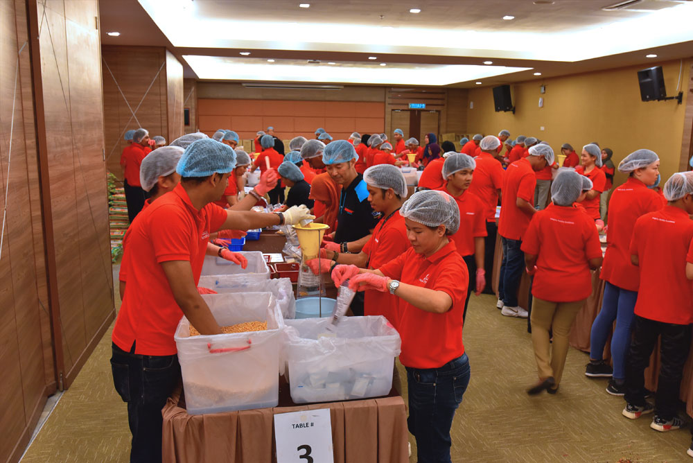 Sunway employees packing the fortified rice